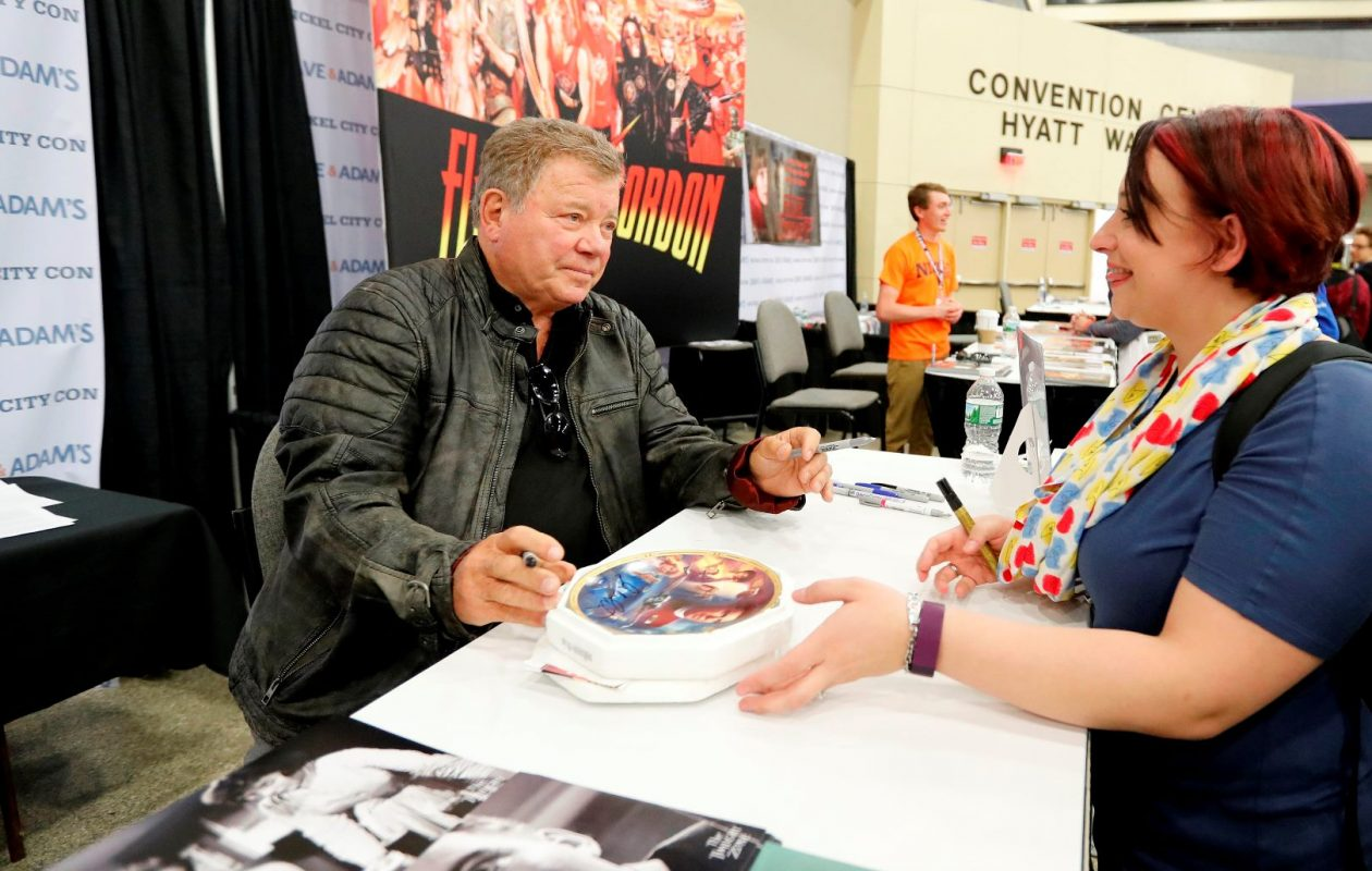 Jessica Schnorr of Lancaster gets an autograph from actor William Shatner during the Nickel City Con at the Buffalo Niagara Convention Center in Buffalo on Saturday, May 20, 2017.  (Mark Mulville/Buffalo News)