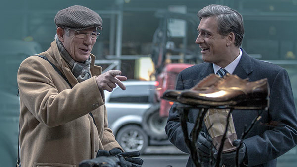 "Richard Gere, left, tries to impress an Israeli politician played by Lior Ashkenazi with a pair of expensive shoes in ""Norman: The Moderate Rise and Tragic Fall of a New York Fixer."""