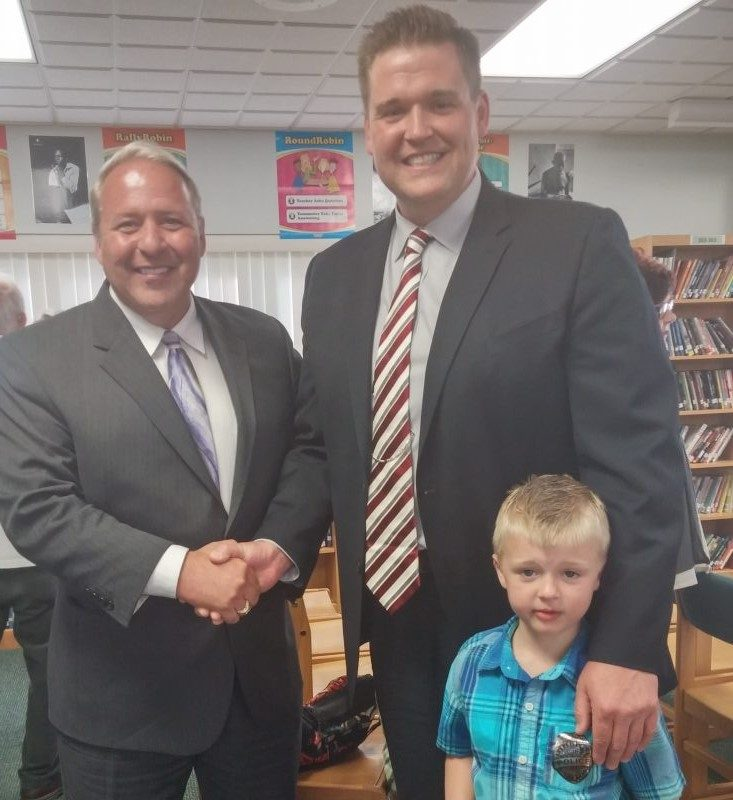 Tonawanda City School Superintendent James Newton, left, welcomes his successor, Timothy A. Oldenburg and his oldest son, Griffin, age 5.