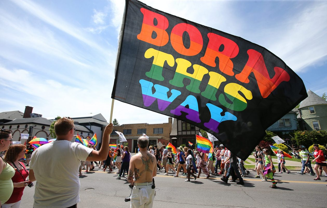 Jimmy Doss, of Buffalo, holds a large flag while watching the annual Pride Parade march along Elmwood Ave. in Buffalo, Sunday, June 1, 2014. (Buffalo News file photo)