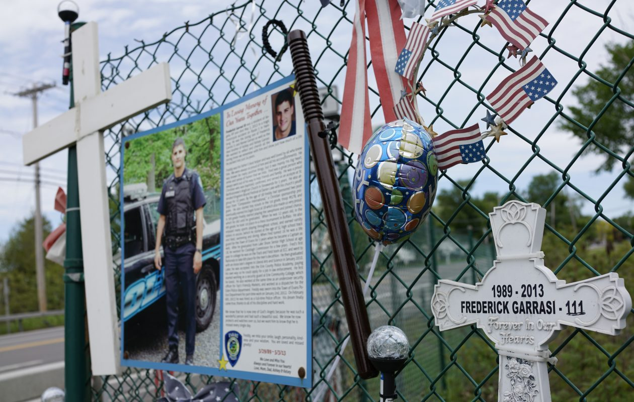 On Lakeshore Road in the Town of Hamburg there's a roadside memorial to Frederick Garrasi III, an off-duty Town of Evans police officer killed in a motorcycle accident there May 3, 2013. This shows the memorial on Wednesday, May 24, 2017.  (Derek Gee/Buffalo News)
