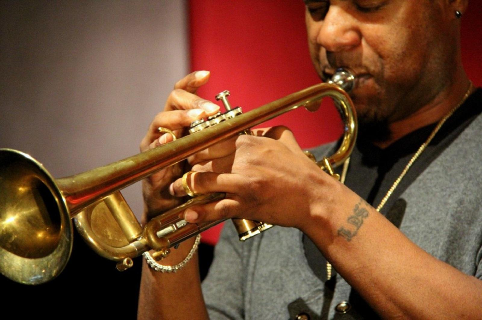 Hip-hop/jazz maestro Russell Gunn has been melting Miers' face all week long.