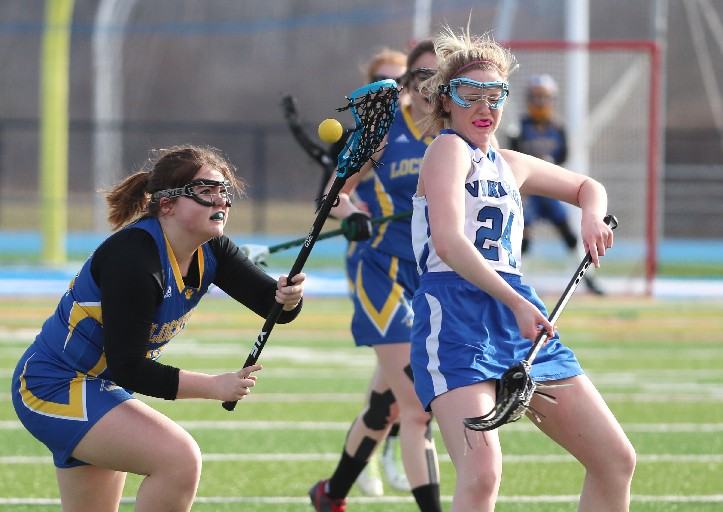 Alyssa Long (left) is among the many girls playing lacrosse in the Lockport School District. (James P. McCoy/Buffalo News file photo)