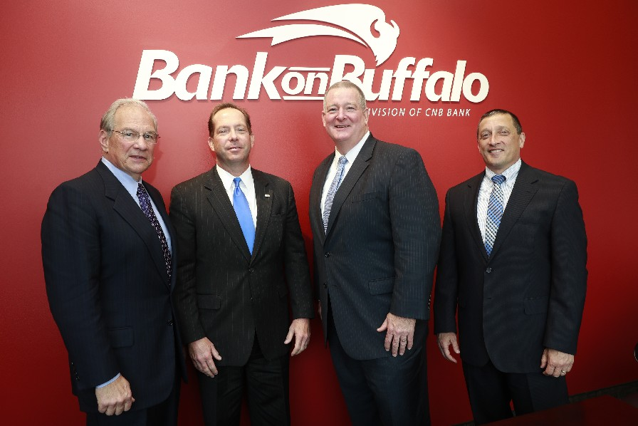 Gerry Murak, left, and Michael Newman of Bank on Buffalo's advisory board, with bank president Martin Griffith and Joseph Bower Jr., president and CEO of CNB Financial. (John Hickey/Buffalo News)