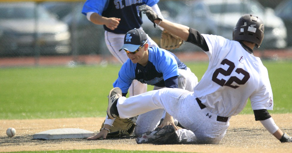 St. Joe's Ryan Sutherland slides into second base against St. Mary's on Saturday. (Photo by Harry Scull Jr./Buffalo News)