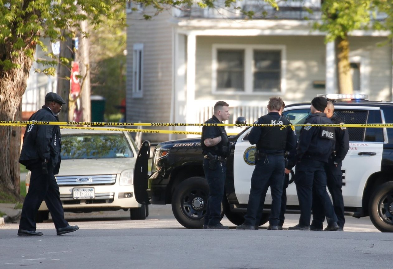 Buffalo police officers at the scene of a police shooting in Black Rock on May 7 that is under investigation by the state Attorney General;s Office. (Robert Kirkham/Buffalo News)