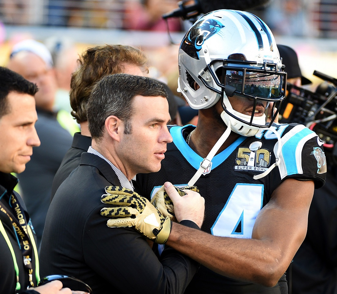 New Bills general manager and former Panthers assistant GM Brandon Beane, left, and cornerback Josh Norman, right, greet one another prior to Super Bowl 50. (Photo courtesy of the Charlotte Observer)