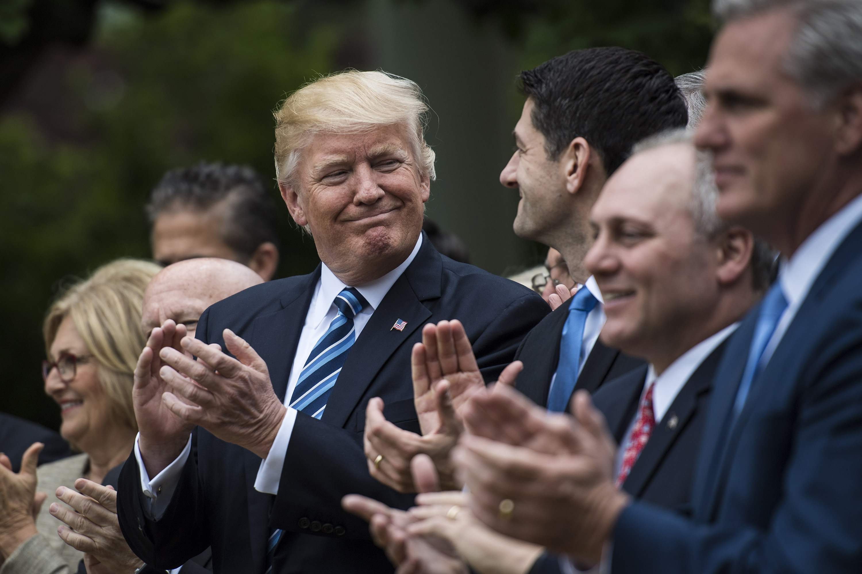 President Donald Trump looks to House Speaker Paul Ryan, R-Wis., after the House pushed through a health-care bill Thursday. The president, Ryan and others made remarks parising their efforts to upend the 2010 Affordable Care Act. (Washington Post)