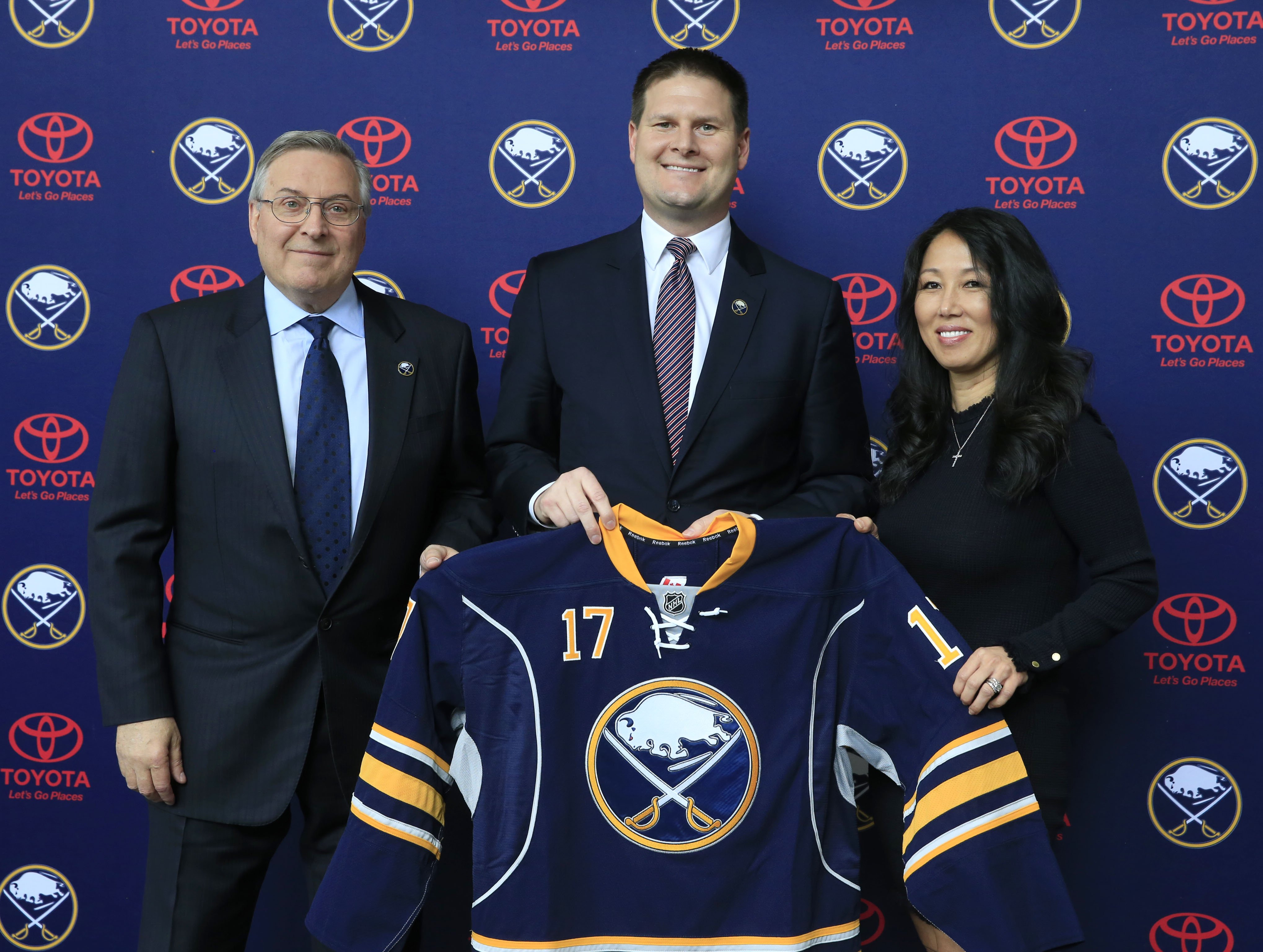 Jason Botterill, center, will lead the Sabres' coaching search and bring the finalists to owners Terry and Kim Pegula. (Harry Scull Jr./Buffalo News)