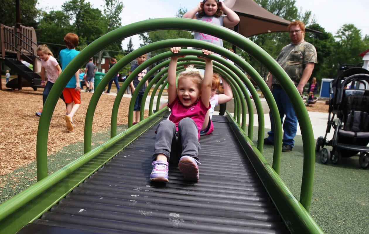 Madison Queer , 4, of Mansfield, Ohio, plays at the new Hamburg Community Playground on Saturday May 27, 2017, in Hamburg. (John Hickey/Buffalo News)