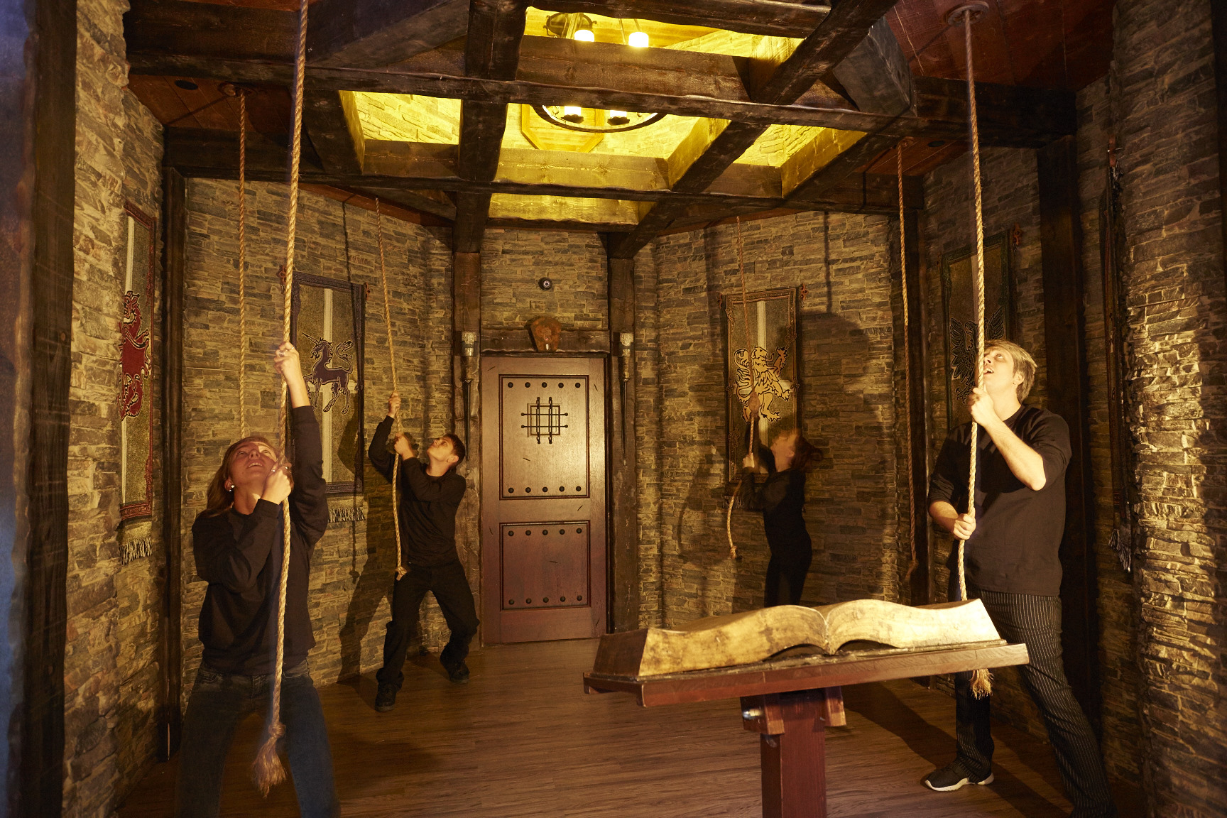 Players work to solve a puzzle in Drago's Castle. (Contributed photo)