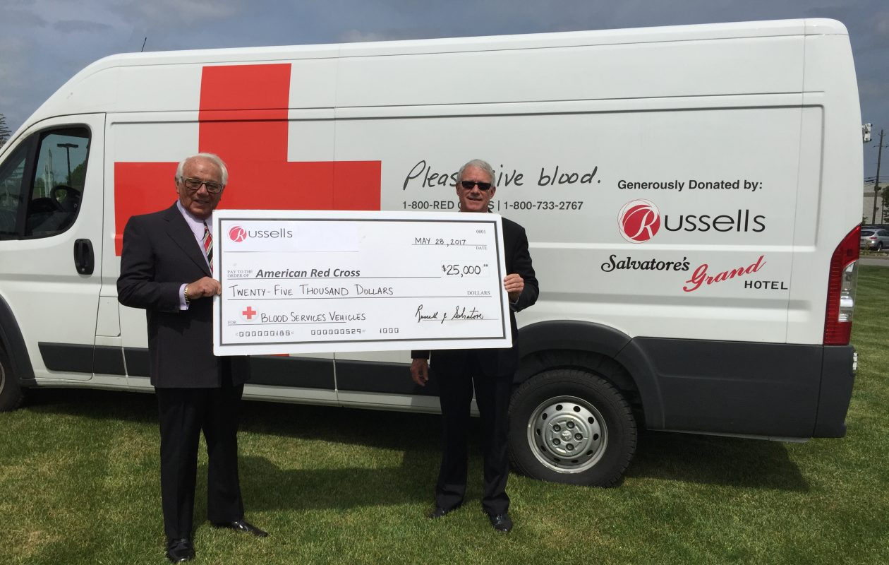 Russell Salvatore, left, presents a $25,000 donation Sunday to American Red Cross, Western New York Chapter Executive Director Chuck Marra.