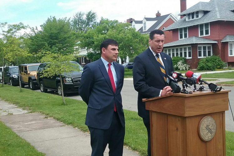 Erie County Legislator Peter Savage, left, and District Attorney John Flynn want to make car break-ins felonies.