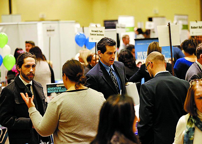 Job seekers talk to prospective employers during the Jobsapalooza career fair at the Buffalo Niagara Marriott in Amherst earlier this year. (Derek Gee/Buffalo News)