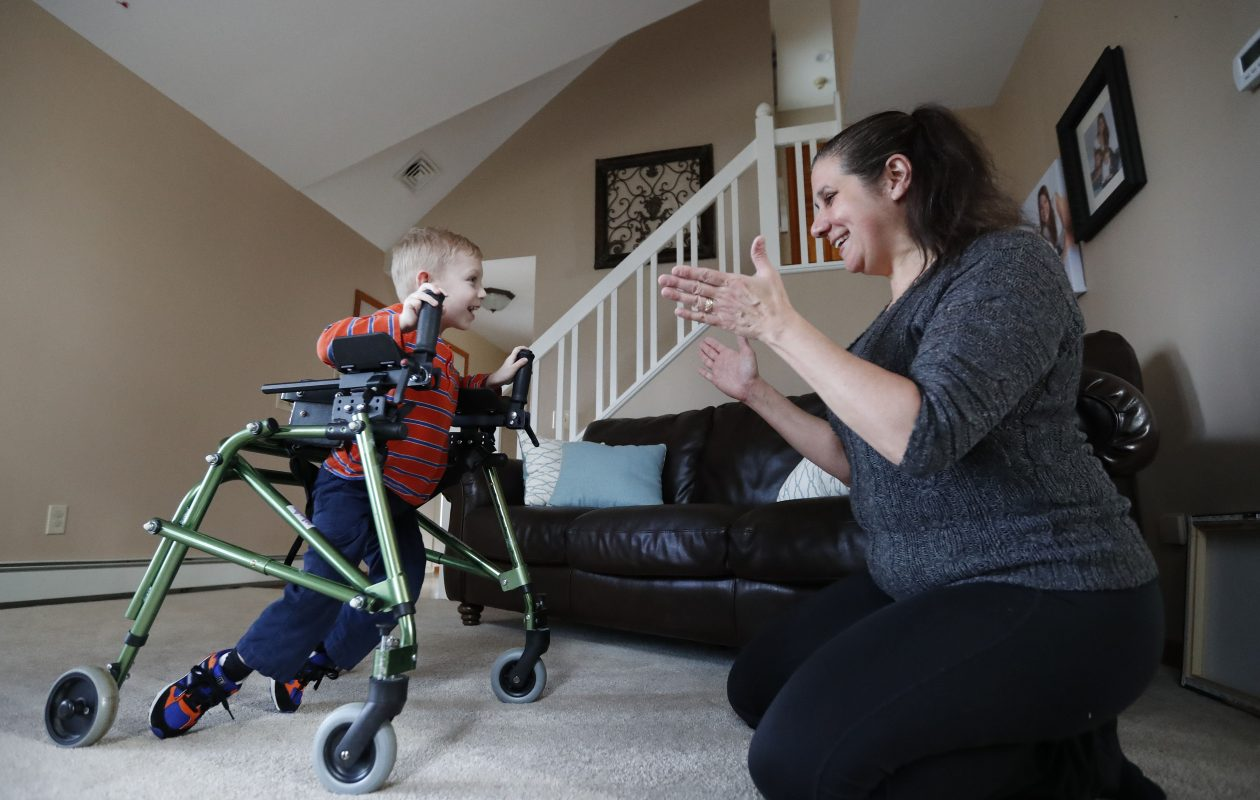 Easton Jordan works on his walking steps with his physical therapist Elizabeth Bailey-Sands Clay at his home in Orchard Park.       (Mark Mulville/Buffalo News)