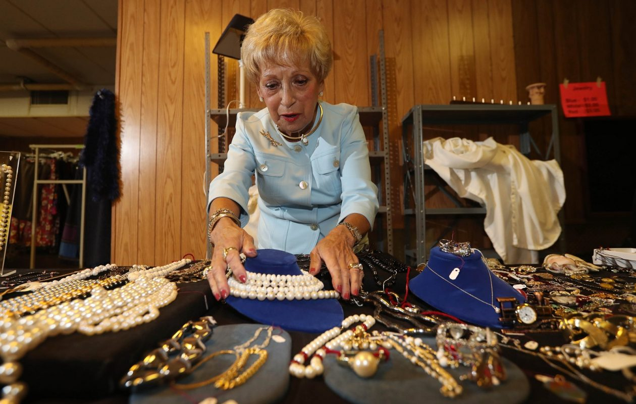 Temple Beth Tzedek held its final rummage sale in June because the synagogue is preparing to move from Getzville Road to North Forest Road. Carolyn Kershanbaum has been running the show for 40 years. Here, she peruses the jewelry. (Sharon Cantillon/Buffalo News)