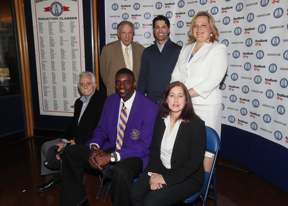 "2017 GBSHOF inductees from left to right, Danny DiLiberto,Willie ""Hutch"" Jones, Jodi Hollander-Correa (for her sister Sandra Hollander) , back row left to right is Charles O'Brien, Micheal Peca and Stacey Schroeder-Watt pose for a photo at Key Bank Center in Buffalo N.Y. on Thursday, June 1, 2017.  (James P. McCoy / Buffalo News)"