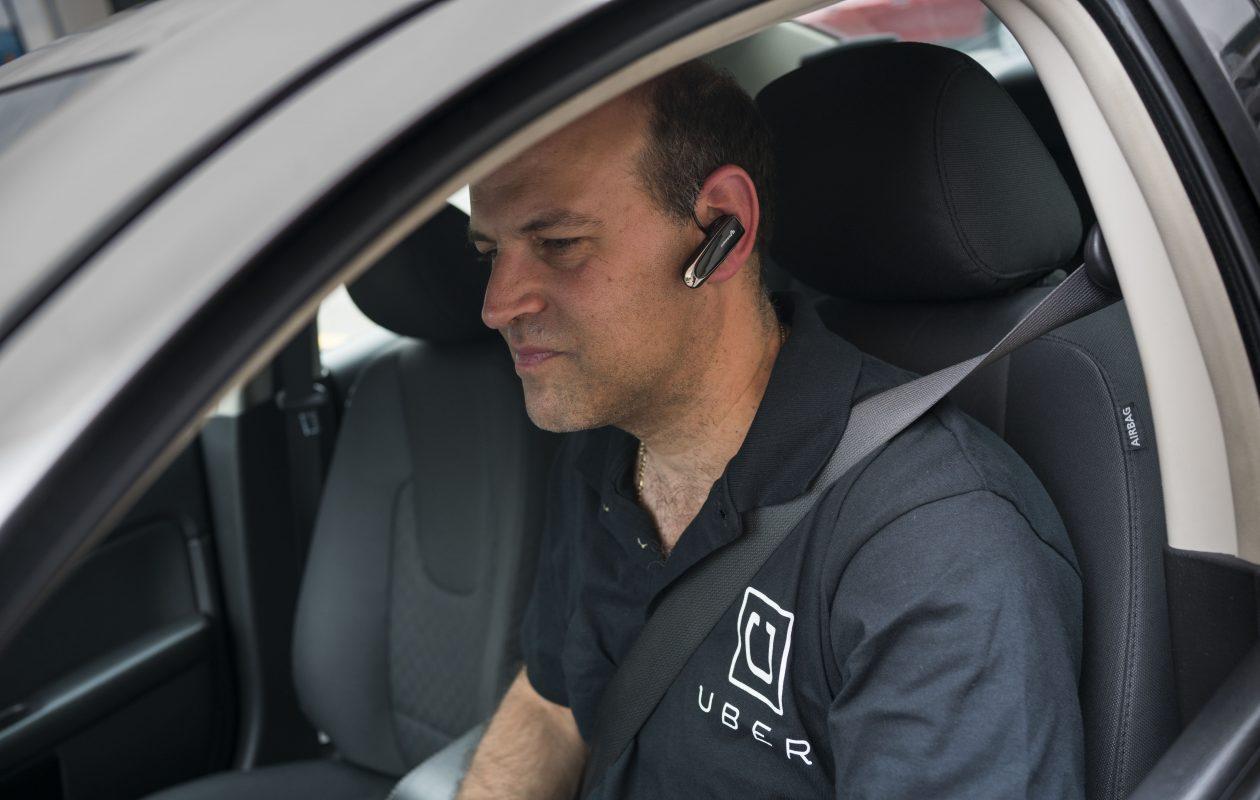 Driver Simon Lissner drops off his second-ever fare on Pearl Street outside the Hyatt Regency Buffalo on Thursday.  (Derek Gee/Buffalo News)