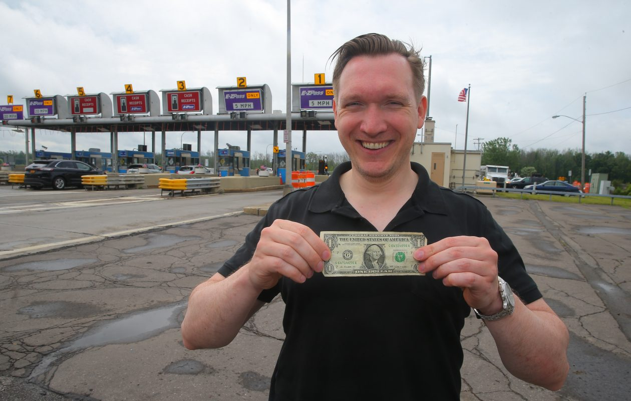 A dollar and a dream: Nate McMurray, Grand Island supervisor, believes the state is finally on the brink of making an official decision to remove the Grand Island toll barriers, where the usual toll is $1. (John Hickey/Buffalo News)