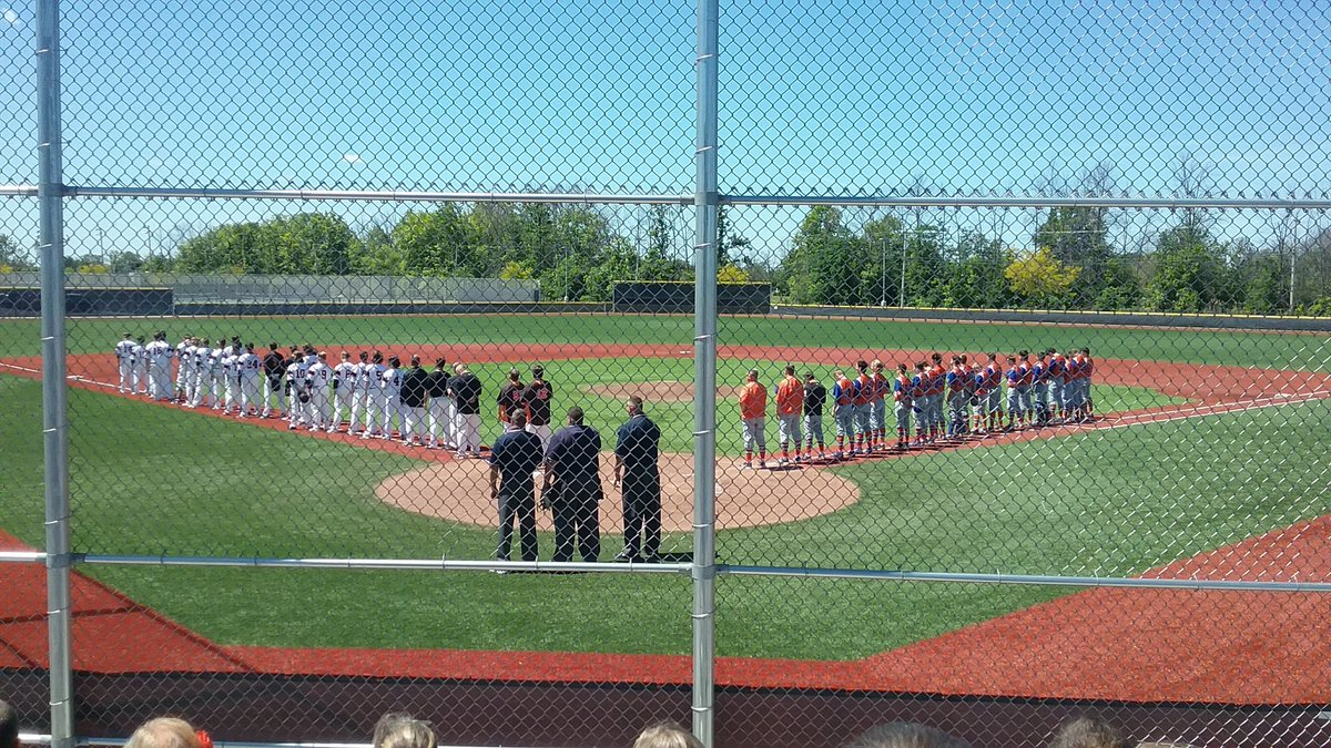 Fredonia and Livonia line up for the National Anthem, just before they started their Class B FWR game.