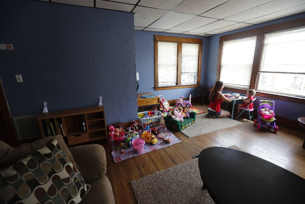 A resident and her daughter use the play area of an apartment in the Cazenovia Recovery Systems' Supportive Living Program, which helps those recovering from addiction get on a healthier track. (Mark Mulville/Buffalo News)
