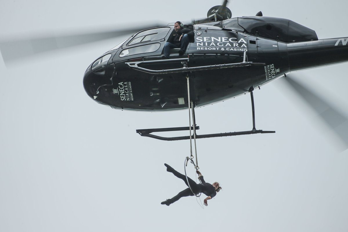 As Erendira Wallenda dangles from a helicopter over Niagara Falls, her husband, Nik Wallenda keeps an eye from the open chopper door. (Derek Gee/Buffalo News)