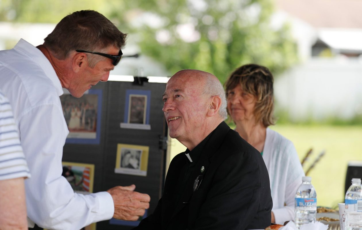 Father Tom Maloney is greeted by parishioners during a retirement party for him at St. Amelia's Church in Tonawanda on Sunday, June 25, 2017. (Mark Mulville/Buffalo News)