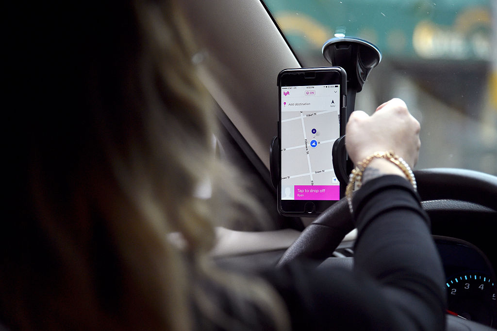 A Lyft driver navigates to her passenger in San Francisco. (Getty Images)