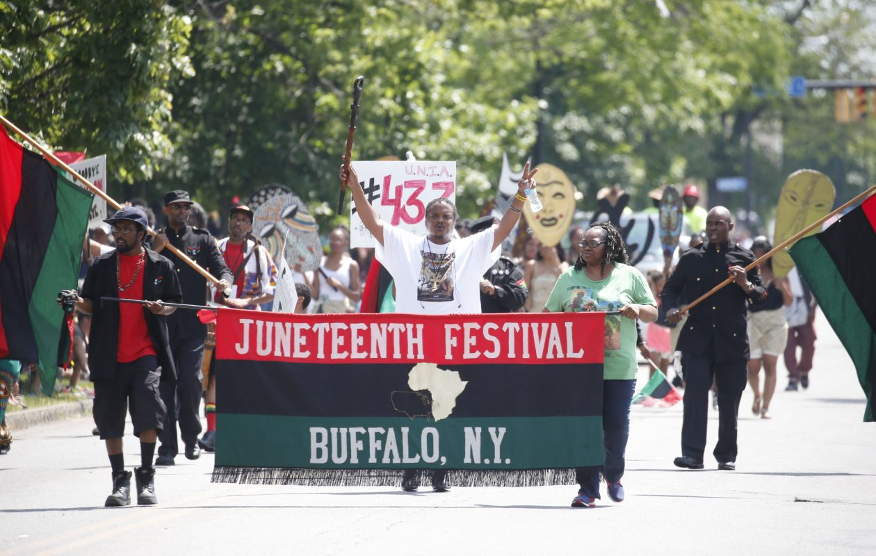Groups march in the parade at the annual Buffalo Juneteenth celebration and parade at MLK Park on Saturday, June 17, 2017.  (Robert Kirkham/Buffalo News)