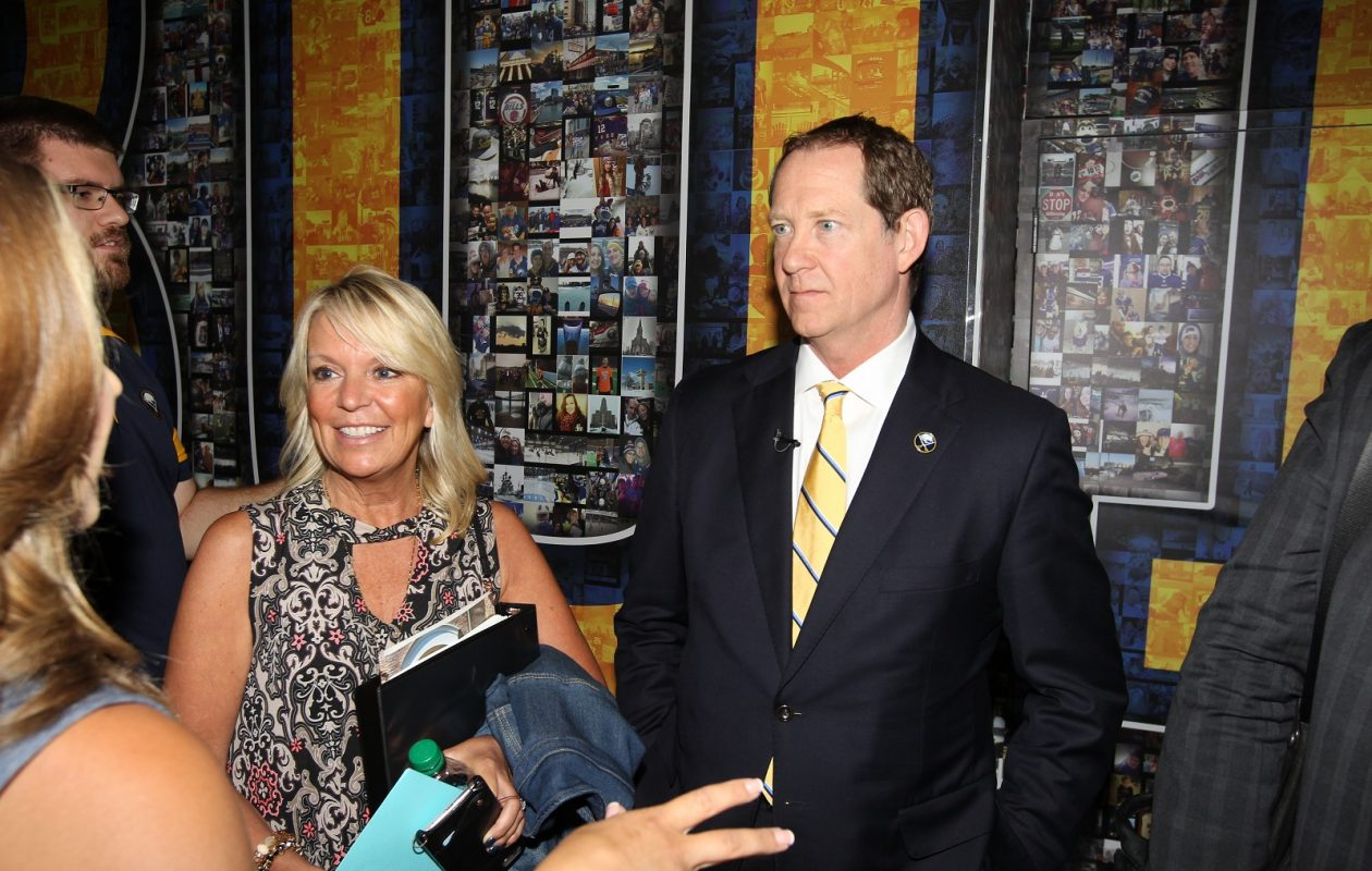 The senator and the Sabres' coach. Karin and Phil Housley pose at KeyBank Center after he was introduced as the Sabres 18th coach. (James P. McCoy / Buffalo News)