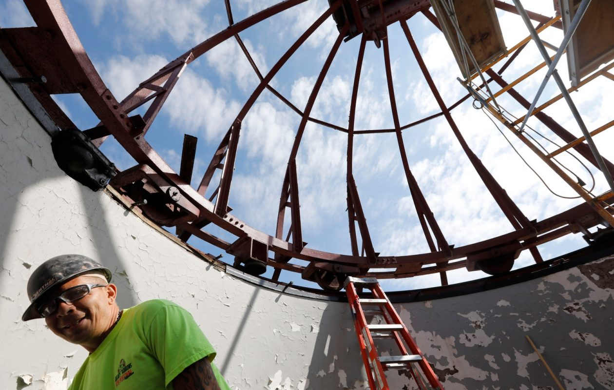 Mike Fleming, foreman for Epic Environmental Contracting, works inside the dome of the 1930 Kellogg Observatory at the Buffalo Museum of Science, where the copper dome has been removed. Derek Gee/Buffalo News