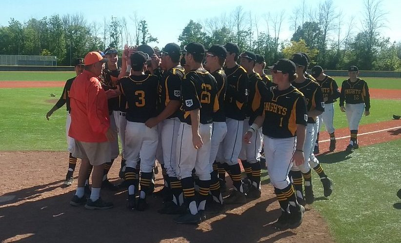 The McQuaid baseball team touches the trophy awarded to the Class AA champion in the Far West Regionals. The Knights beat Clarence, 5-4.