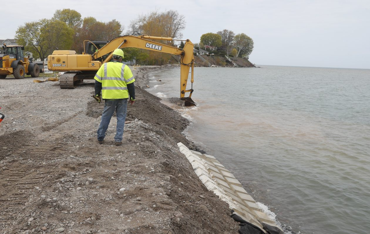 Niagara County Highway Department workers have been building up the shoreline in Olcott to protect against Lake Ontario's high water. (John Hickey/Buffalo News)