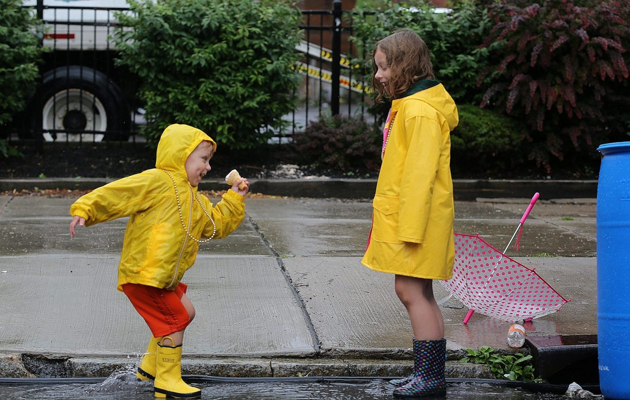 Why can't everyone be as happy on a rainy weekend day as Nico and Riley Kloc of West Seneca, were during the Taste of Buffalo in 2014? (News file photo)