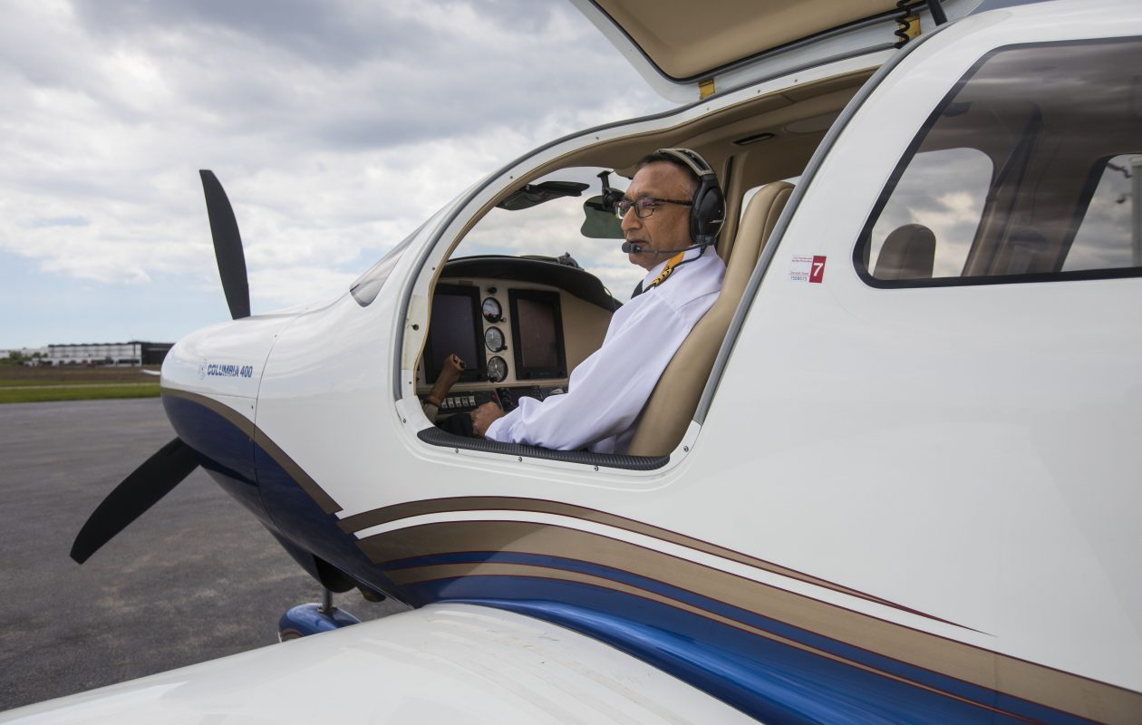 Retired Clarence businessman Ravinder K. Bansal completed a solo flight around the world in this single-engine Cessna 400 to raise money for a hospital in India.  He raised $160,000 towards his goal of $750,000. Bansal is trying to raise enough money to purchase an MRI machine for the hospital. He's shown in his Cessna at Prior Aviation in Cheektowaga, Wednesday, June 21, 2017.  (Derek Gee/Buffalo News)