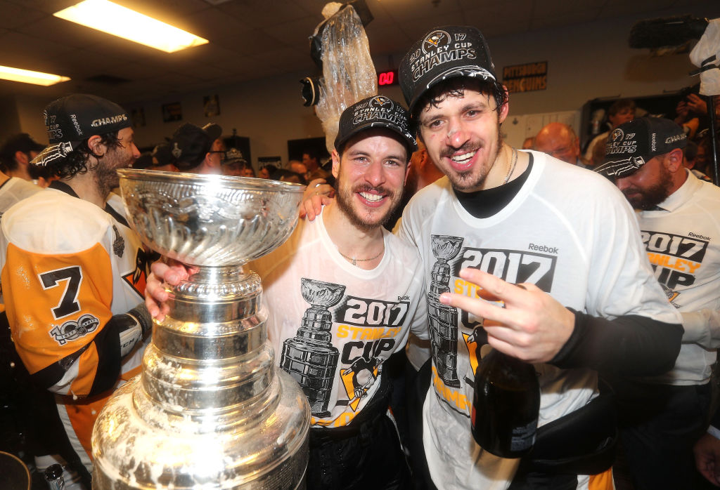 Sidney Crosby, left, and Evgeni Malkin celebrate in the dressing room after Game Six (Getty Images).