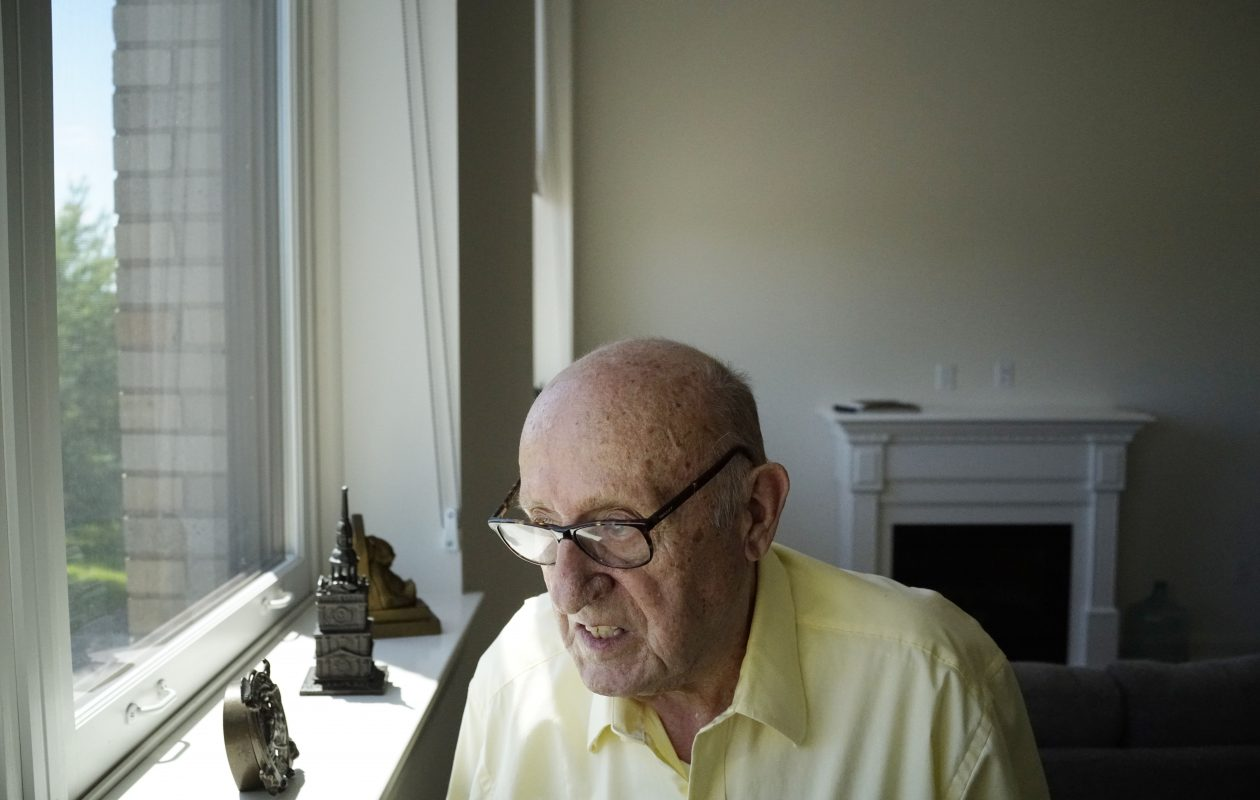 James English, who graduated from Depew High School in 1947, looks out the window of his new apartment in the former school after moving in Wednesday, June 7, 2017. The school has been transformed into the Terrace Park Apartments, a 48-unit building for residents 55 or older.  (Derek Gee/Buffalo News)