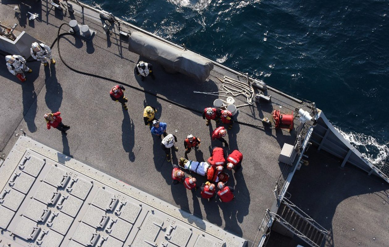 In a photo provided by Japanese authorities, American military personnel prepare to transfer an injured person from the USS Fitzgerald, which collided with a merchant ship off the coast of Japan, June 17, 2017. Seven Navy sailors were missing after the collision in a busy sea lane, and the badly damaged destroyer was towed to an American Naval base in Japan. (Japan Ministry of Defense via The New York Times)