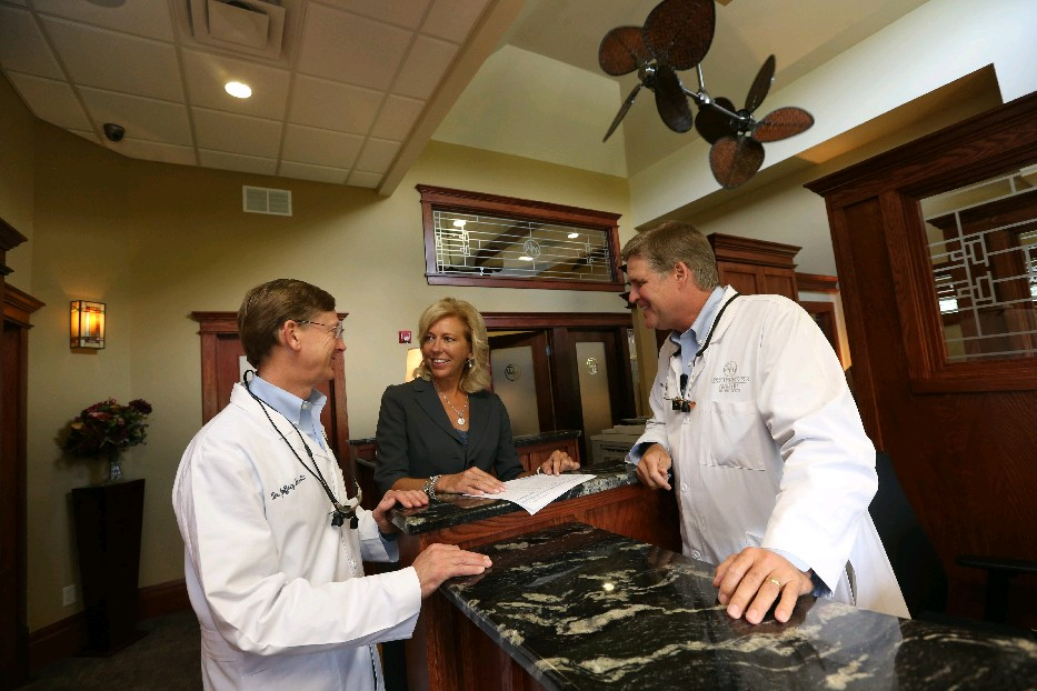 """""""What's happening is that medical insurances are so costly that employers have to make a choice and don't cover so much of the dental,"""" says Maria R. Miecyjak, flanked by her dentist-bosses, Dr. Jeff Martin, left, and Dr. Scott Westermeier. (Sharon Cantillon/Buffalo News file photo)"""