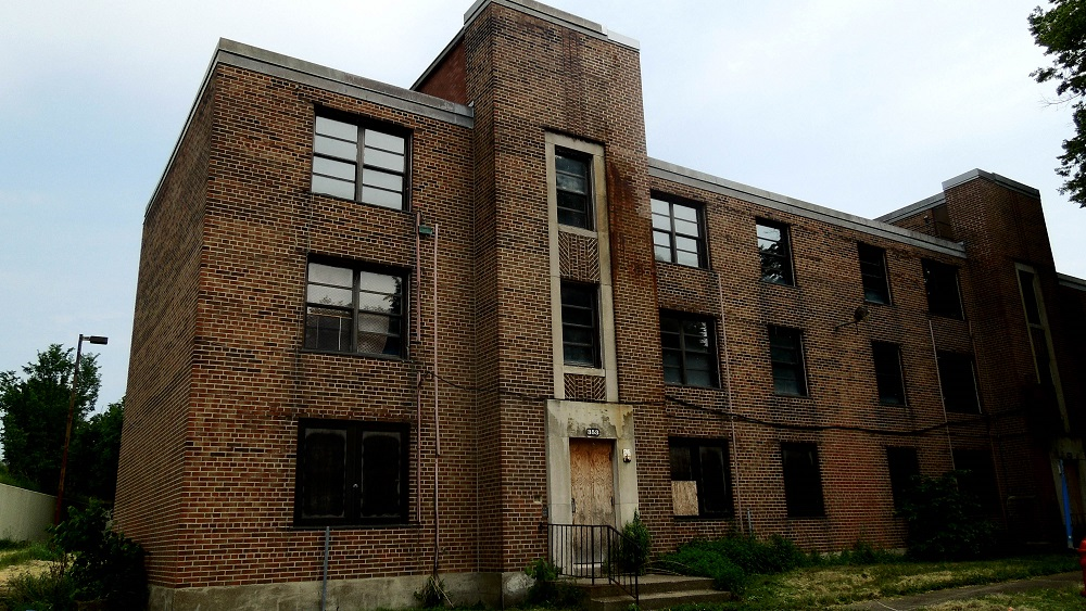 Photo of the currently-vacant apartments at 353 Alabama Street, in Buffalo's Commodore Perry Housing Projects.  Mrs. Marilyn Cannon was murdered here on the building's second-story landing, early in the morning of February 7, 1957. (Photo by Kate Shea, special to The News)