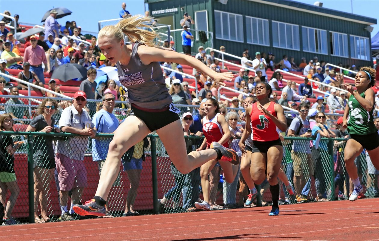 Orchard Park's Jenna Crean won the 100, 200 and 400 titles in Division I for the second straight year at the Section VI track and field championship meet. (Harry Scull Jr./Buffalo News)
