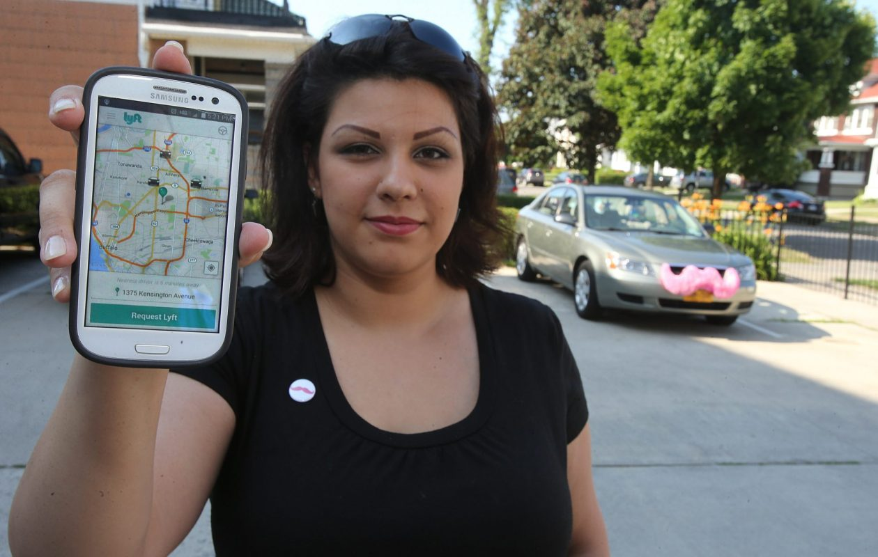 Lyft driver Jennifer Torres, of Buffalo, uses a smartphone app for ride requests in 2014, when the company briefly operated in the region. (News file photo)