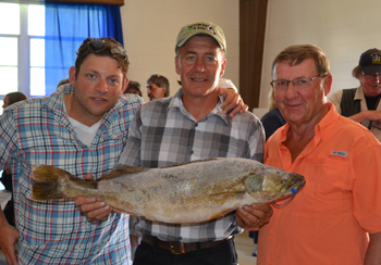Pat O'Brien (center) with his winning 12.44-pound walleye and his two fishing partners – Nick Miller on the left and Dr. Jim Stoll on the right.
