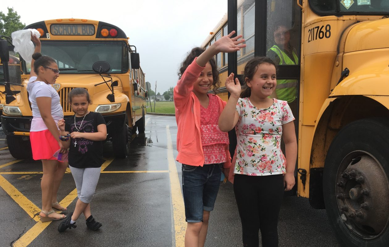 Jayla Rios and Juliana Santiago, fourth-graders at Waterfront Elementary School, wave goodbye to friends Friday, on the last day of school. Behind them: Gabriella Santiago and Ciani Olabode. (Sean Kirst/Buffalo News)