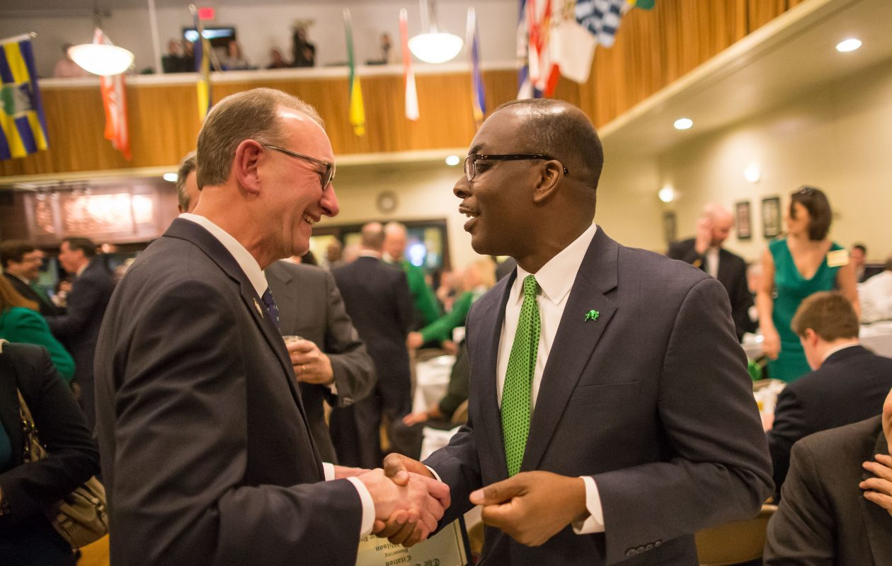 Schroeder and Brown shake hands during the 46th annual Civic Luncheon at the Buffalo Irish Center on St. Patrick's Day on Friday, March 17, 2017. (Derek Gee/Buffalo News)