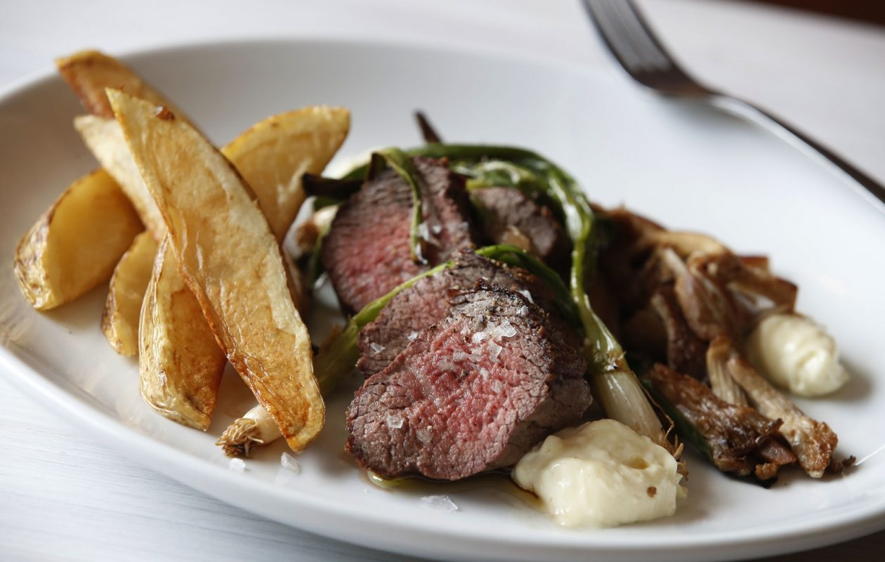 Lait Cru Brasserie's steak frites come with roasted vegetables and horseradish cream. (Sharon Cantillon/Buffalo News)