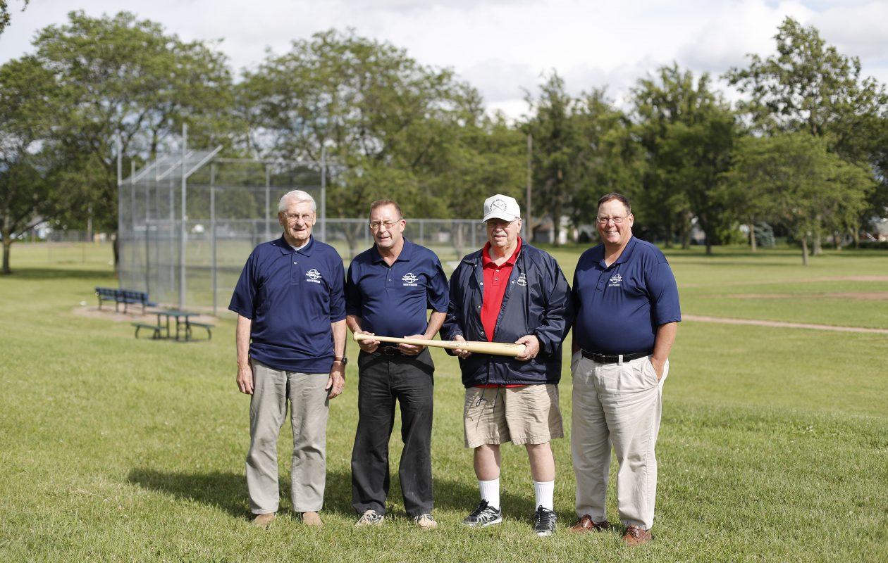 Officers for the Lockport Midget Baseball League, from left: Charlie Sobieraski, chairman; Scott Huntington, treasurer; Joe Kibler, past chairman; and David Davidson, president, at the Outwater Park field. (Mark Mulville/Buffalo News)