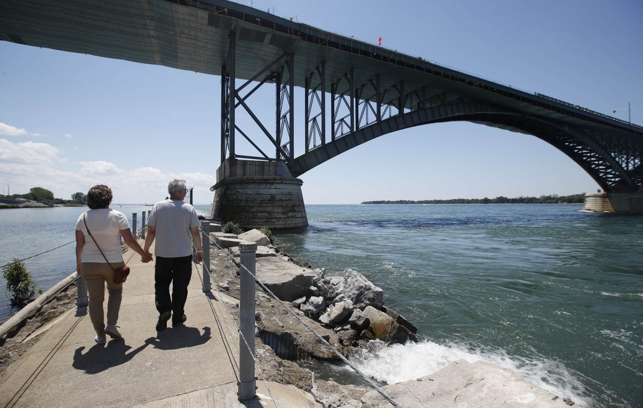 Michelle and Mark Griep, of Minneapolis, Minn., walk along Bird Island Pier, approaching the Peace Bridge. (Sharon Cantillon/Buffalo News)