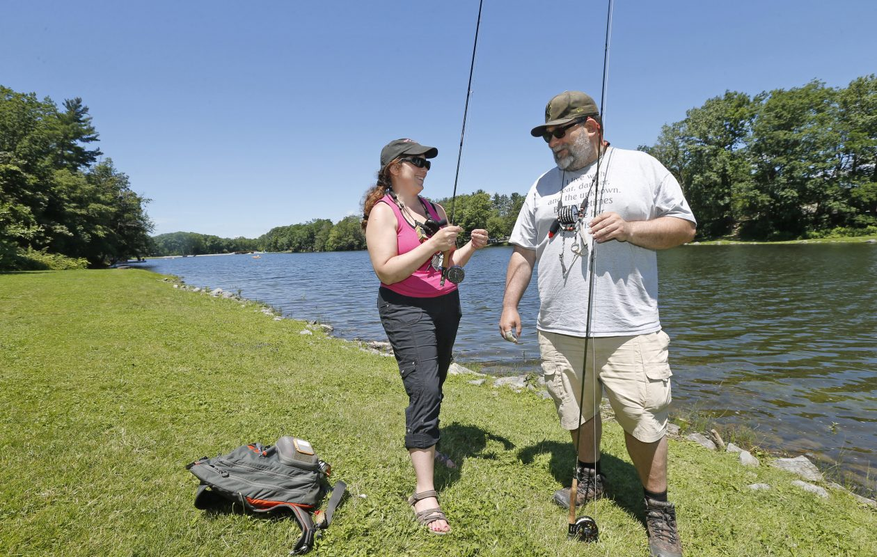 Avid fly-fishermen Dave Witt, and his wife, Lynn, of West Seneca, work on their casting technique at Green Lake on Monday, July 3, 2017. (Robert Kirkham/Buffalo News)