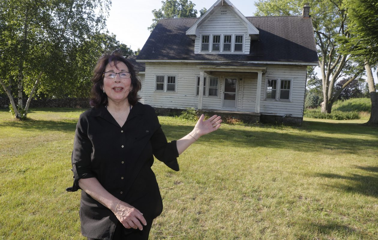 Carol Conwall of Clarence advocates for saving and restoring the home at 10375 Main St. (John Hickey/Buffalo News)